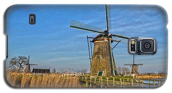 Galaxy S5 Case featuring the photograph Windmills And Bridge Near Kinderdijk by Frans Blok