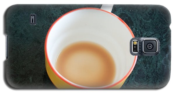 Galaxy S5 Case featuring the photograph A Cup With The Remains Of Tea On A Green Table by Ashish Agarwal