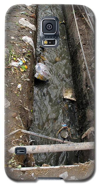 Galaxy S5 Case featuring the photograph A Dirty Drain With Filth All Around It Representing A Health Risk by Ashish Agarwal