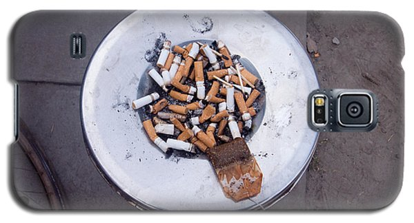 Galaxy S5 Case featuring the photograph A Lot Of Cigarettes Stubbed Out At A Garbage Bin by Ashish Agarwal