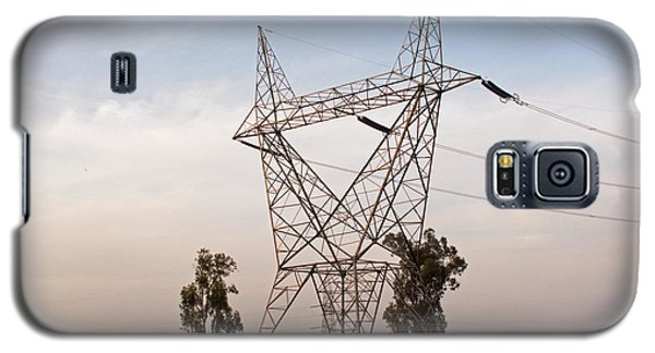 Galaxy S5 Case featuring the photograph A Transmission Tower Carrying Electric Lines In The Countryside by Ashish Agarwal