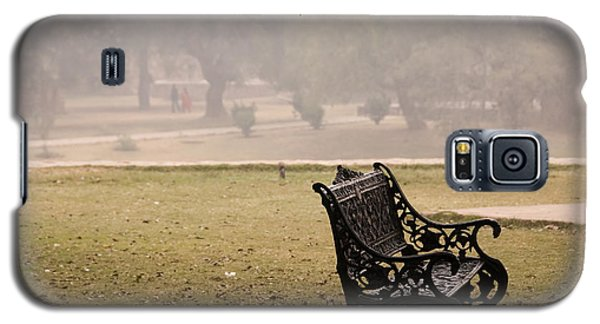 Galaxy S5 Case featuring the photograph A Wrought Iron Black Metal Bench Under A Tree In The Qutub Minar Compound by Ashish Agarwal