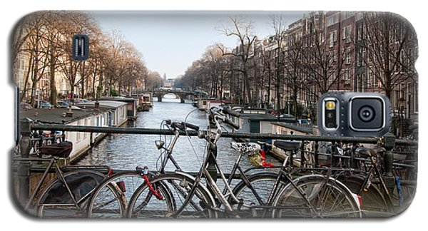 Galaxy S5 Case featuring the digital art Bikes On The Canal In Amsterdam by Carol Ailles