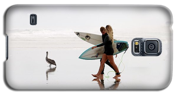 Galaxy S5 Case featuring the photograph Surfers And A Pelican by Alice Gipson
