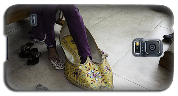 Galaxy S5 Case featuring the photograph Trying On A Very Large Decorated Shoe by Ashish Agarwal