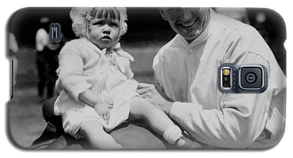 Galaxy S5 Case featuring the photograph Walter Johnson Holding A Baby - C 1924 by International  Images