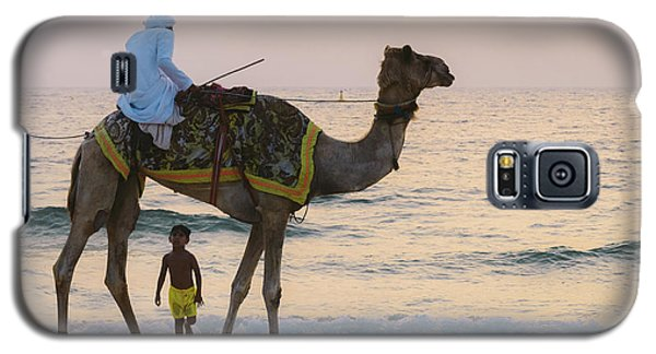 Little Boy Stares In Amazement At A Camel Riding On Marina Beach In Dubai, United Arab Emirates -  Galaxy S5 Case