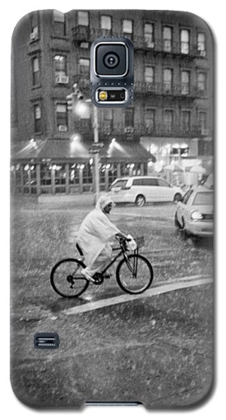 Galaxy S5 Case featuring the photograph Rider In The Rain by Dave Beckerman