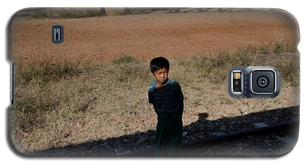 A Boy In Burma Looks Towards A Train From The Shadows Galaxy S5 Case by Jason Rosette