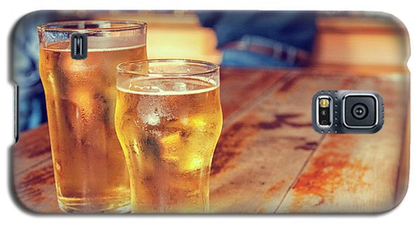 Galaxy S5 Case featuring the photograph Beers In A Pub by Patricia Hofmeester
