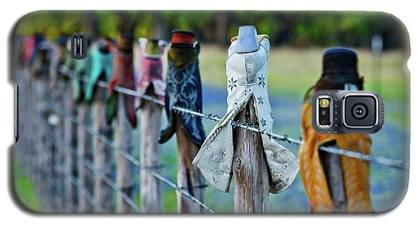 Galaxy S5 Case featuring the photograph Boots On The Fence by Linda Unger
