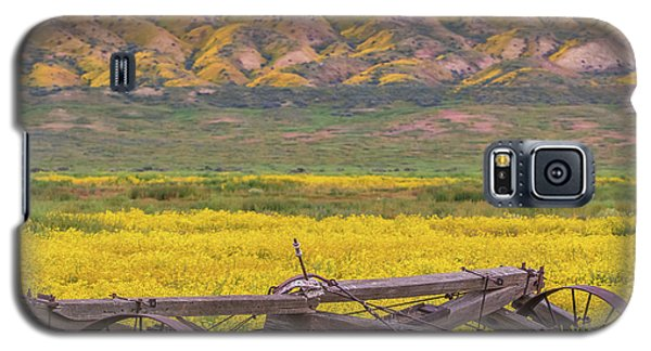 Galaxy S5 Case featuring the photograph Broken Wagon In A Field Of Flowers by Marc Crumpler