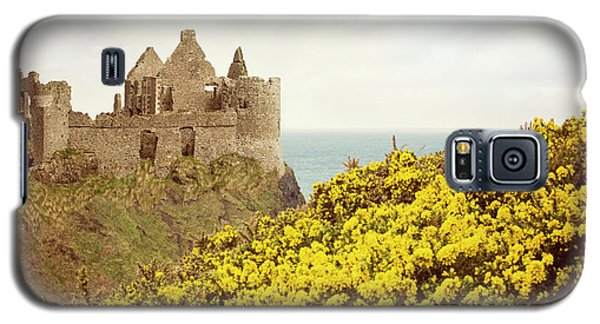 Galaxy S5 Case featuring the photograph Castle Ruins And Yellow Wildflowers Along The Irish Coast by Juli Scalzi