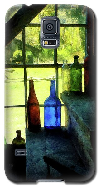 Galaxy S5 Case featuring the photograph Colored Bottles On Steps by Susan Savad
