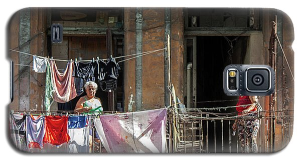 Galaxy S5 Case featuring the photograph Cuban Women Hanging Laundry In Havana Cuba by Charles Harden