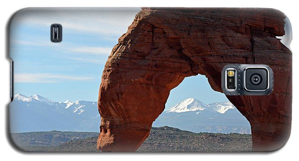 Galaxy S5 Case featuring the photograph Delicate Arch With Wispy Clouds by Bruce Gourley