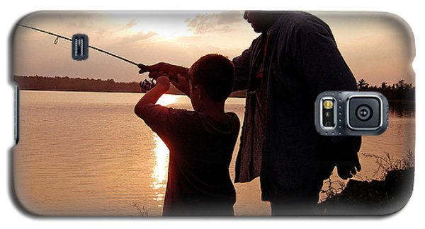 Galaxy S5 Case featuring the photograph Fishing At Sunset Grandfather And Grandson by A Gurmankin