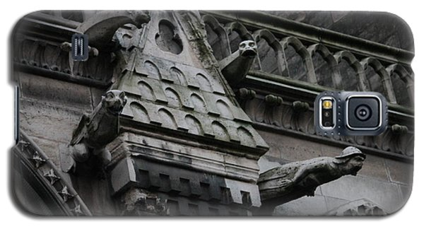 Galaxy S5 Case featuring the photograph Four Gargoyles On Notre Dame North by Christopher Kirby