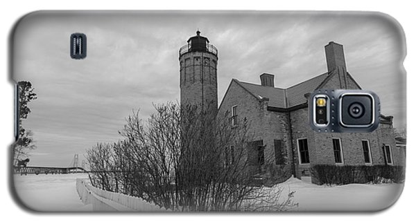 Galaxy S5 Case featuring the photograph Lighthouse And Mackinac Bridge Winter Black And White  by John McGraw