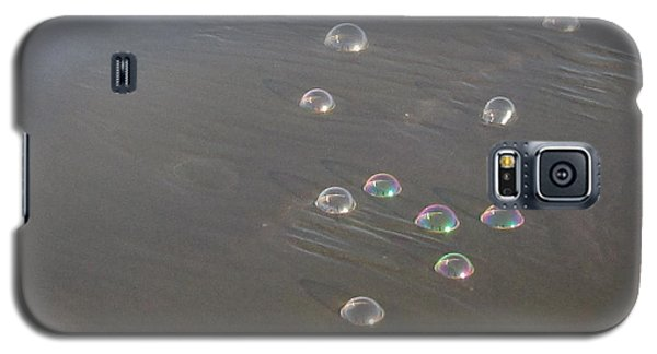 Galaxy S5 Case featuring the photograph March Of The Bubbles by Marie Neder