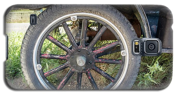Galaxy S5 Case featuring the photograph Old Truck Tire In Rural Rocky Mountain Town by Peter Ciro