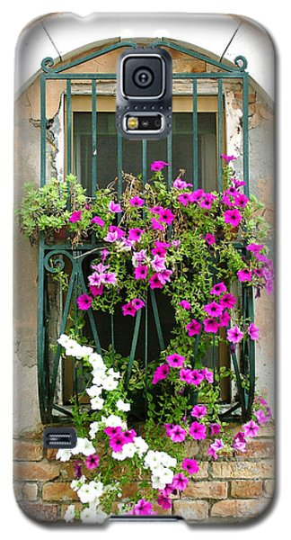 Galaxy S5 Case featuring the photograph Petunias Through Wrought Iron by Donna Corless