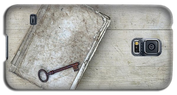 Galaxy S5 Case featuring the photograph Rusty Key On The Old Tattered Book by Michal Boubin