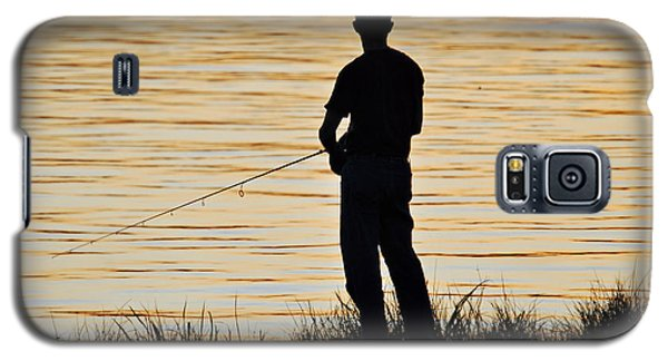 Galaxy S5 Case featuring the photograph Silhouetted Fisherman by Teresa Blanton