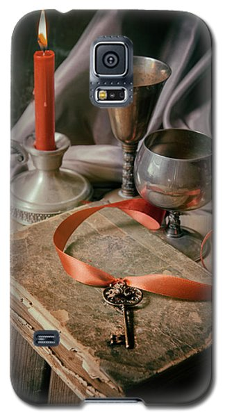 Galaxy S5 Case featuring the photograph Still Life With Old Book And Metal Dishes by Jaroslaw Blaminsky