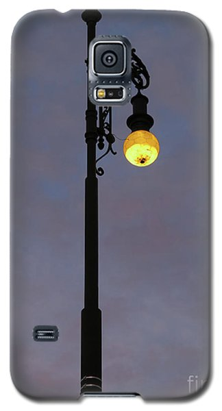 Galaxy S5 Case featuring the photograph Street Lamp Shining At Dusk by Michal Boubin