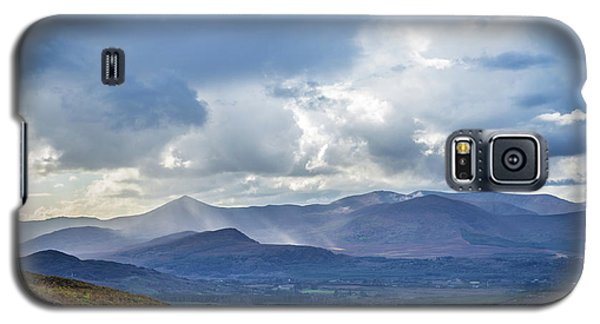 Galaxy S5 Case featuring the photograph Sun Rays Piercing Through The Clouds Touching The Irish Landscap by Semmick Photo