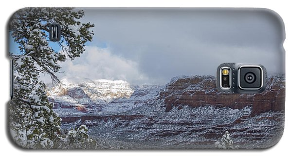 Galaxy S5 Case featuring the photograph Sunlit Snowy Cliff by Laura Pratt