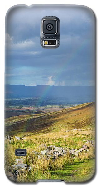 Galaxy S5 Case featuring the photograph Sunshine And Raining Down With Rainbow On The Countryside In Ire by Semmick Photo
