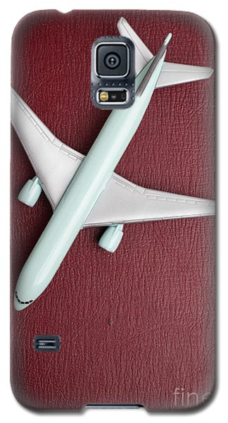 Galaxy S5 Case featuring the photograph Toy Airplane Over Red Book Cover by Edward Fielding