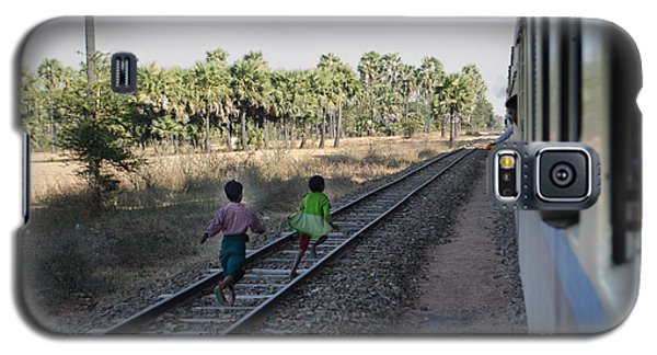 Galaxy S5 Case featuring the photograph Two Kids Run Along And Follow Train In Burma by Jason Rosette