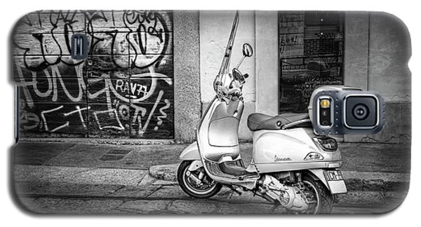 Galaxy S5 Case featuring the photograph Vespa Scooter In Milan Italy In Black And White  by Carol Japp