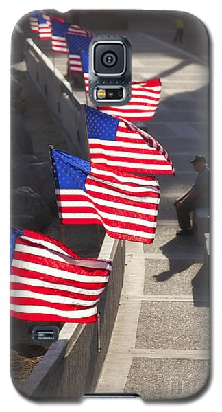 Galaxy S5 Case featuring the photograph Veteran With United States Flags by John A Rodriguez
