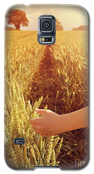 Galaxy S5 Case featuring the photograph Walking Through Wheat Field by Lyn Randle