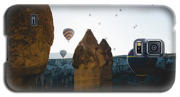 hot air balloons for tourists flying over rock formations at sunrise in the valley of Cappadocia. Galaxy S5 Case