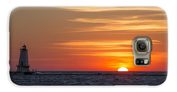 Galaxy S6 Case featuring the photograph Ludington North Breakwater Light At Sunset by Adam Romanowicz