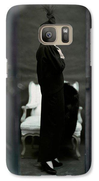 A Model Wearing An Adele Simpsons Ensemble Galaxy Case by John Rawlings