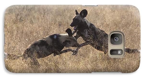 Galaxy Case featuring the photograph African Wild Dogs Play-fighting by Liz Leyden