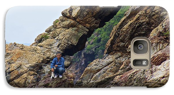 Galaxy Case featuring the photograph Fisherman On Rocks  by Sarah Mullin