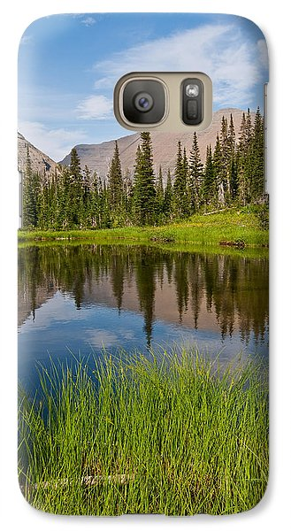 Galaxy Case featuring the photograph Mountains Reflected In An Alpine Lake by Jeff Goulden