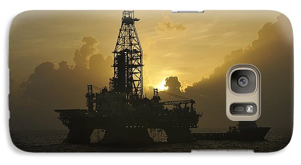 Galaxy Case featuring the photograph Offshore Oil Rig With Sun And Clouds by Bradford Martin