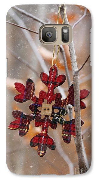 Galaxy Case featuring the photograph Ornament Hanging On Branch With Snow Falling by Sandra Cunningham