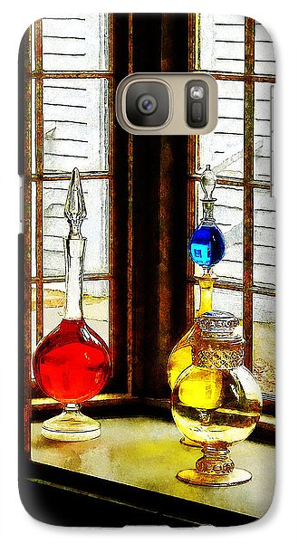 Galaxy Case featuring the photograph Pharmacist - Colorful Bottles In Drug Store Window by Susan Savad