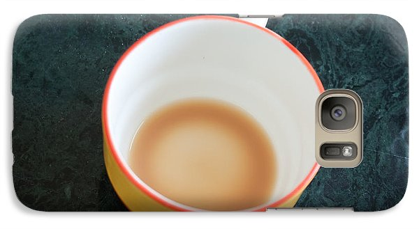 Galaxy Case featuring the photograph A Cup With The Remains Of Tea On A Green Table by Ashish Agarwal