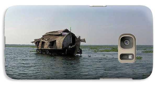 Galaxy Case featuring the photograph A Houseboat Moving Placidly Through A Coastal Lagoon In Alleppey by Ashish Agarwal