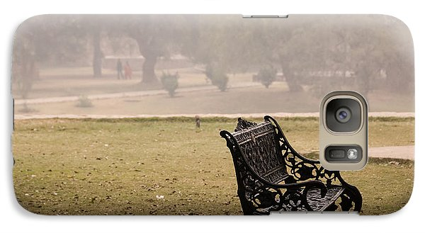 Galaxy Case featuring the photograph A Wrought Iron Black Metal Bench Under A Tree In The Qutub Minar Compound by Ashish Agarwal